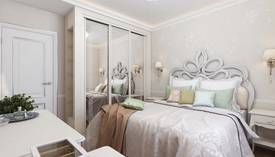 Шкафы-купе в интерьере маленькой спальни