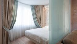 Фото дизайна интерьера спальни-гостиной