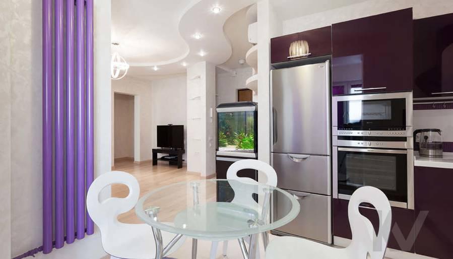 Фото дизайна гостиной-кухни - 3